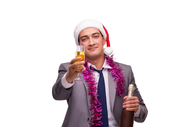 Молодой бизнесмен празднует рождество в офисе