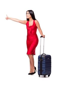 白い背景で隔離のスーツケースを持つ女性