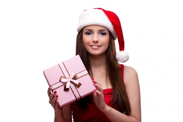 白で隔離されるクリスマスの概念で若いサンタガール