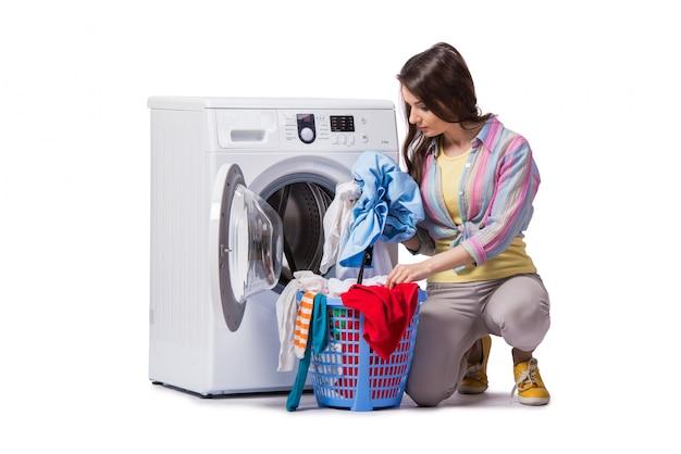 白で隔離される洗濯をした後疲れた女性
