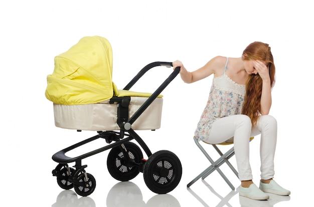 Женщина с ребенком и коляска на белом