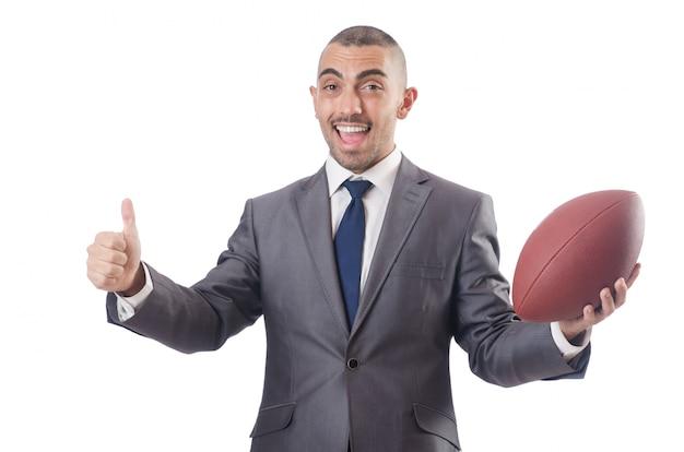 Человек с американским футбольным мячом на белом