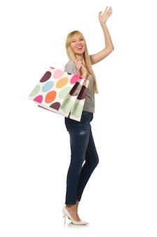 白で隔離される買い物袋を持つ女性