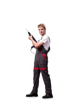白で隔離ドリル穿孔器を持つ若い修理工