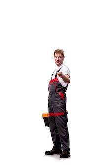白で隔離つなぎ服を着ている若い建設労働者
