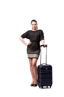 白で隔離されるスーツケースを持つ若い女
