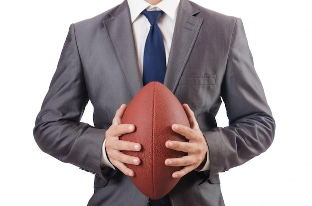 白で隔離アメリカンフットボールのボールを持つ男