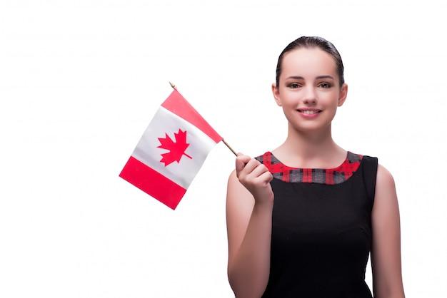 白で隔離されるカナダの国旗を保持している女性