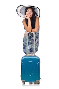 白で隔離されるスーツケースを持つ女性