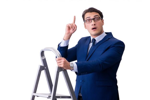 Бизнесмен на вершине лестницы изолированы