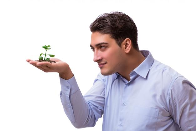 白で隔離緑の苗を持って男