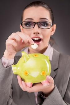実業家と貯金箱のビジネスコンセプト