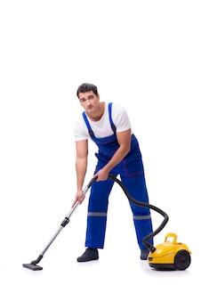 白の掃除機をしているつなぎ服の男