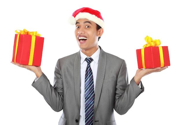 クリスマスプレゼントを持ったビジネスマン
