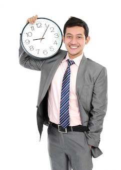 大時計を示す実業家