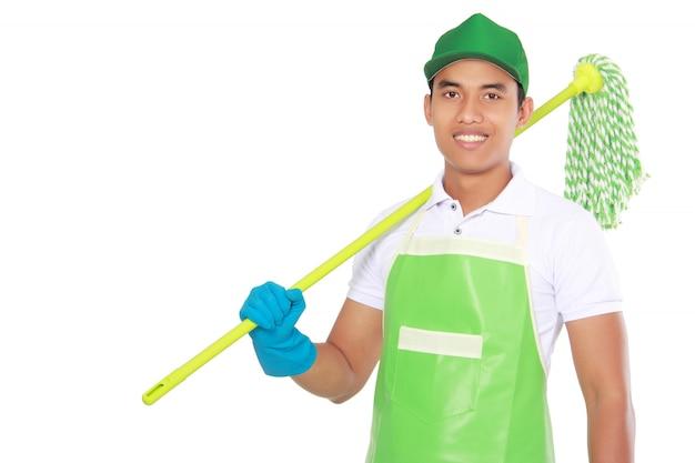 Портрет молодого человека с уборочной техникой