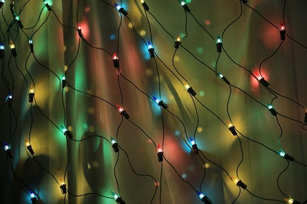 抽象的な輝く背景クリスマス新年ランタンソフトセレクティブフォーカストーンの写真