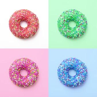 Набор красочных пончиков. отличный свежий вкусный фиолетовый зеленый синий розовый пончик в глазури. коллаж