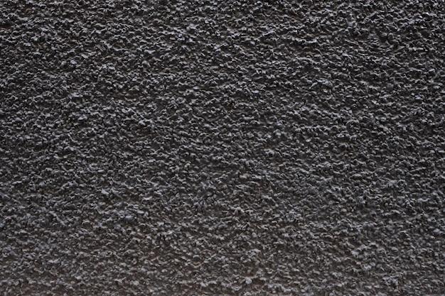 濃い色の花崗岩の壁の背景