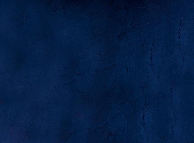ネイビー抽象的な装飾的なダークブルーのスタッコ壁の基金。テクスチャ背景