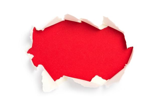 引き裂かれたフレームの背景を持つ紙
