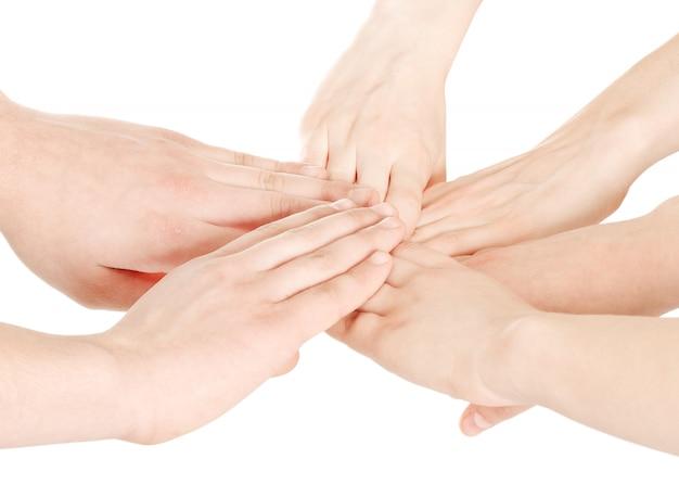 Соединенные руки на белом фоне