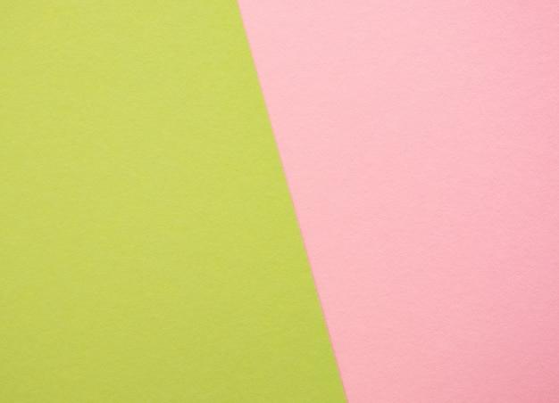 緑とピンクの紙のテクスチャ背景