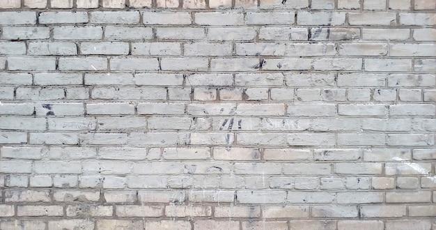 壁テクスチャ背景。白いグランジブロック