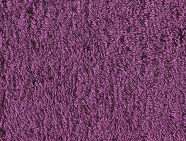 バイオレット繊維タオルの質感。バイオレットバスタオルの背景。