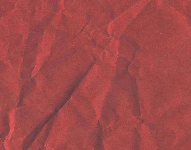 赤のカラフルな紙の背景。紫の段ボールの質感