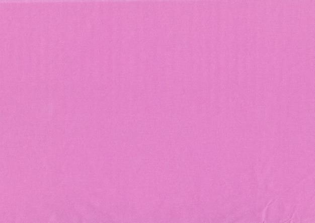 ピンククラフトクレープ紙のテクスチャのクローズアップ。