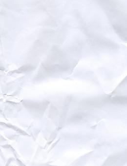 しわ紙のテクスチャや背景。しわくちゃの紙のテクスチャ