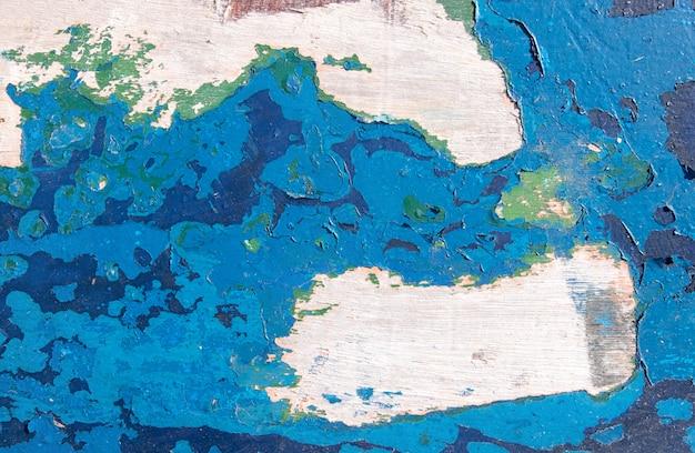 グランジテクスチャ、木製の表面から剥離青いペンキ