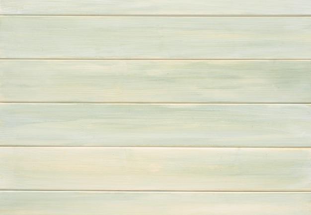 薄緑黄色いテーブル木製の板。コピースペースを備えた高解像度のテーブルイメージ