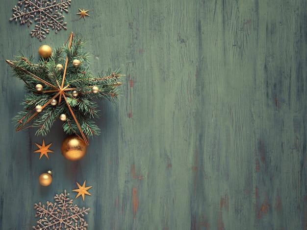 自然なモミの小枝と金色のつまらないもの、装身具、光沢のある輝く雪の結晶をあしらった金属製の金色の星の形。