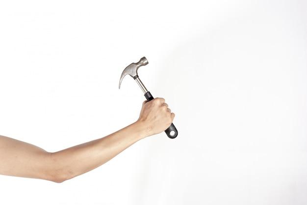 労働者の日の概念、白い背景で隔離のハンマーを持っている右手
