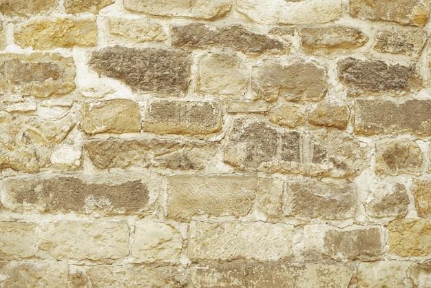 ベージュの石のモザイクの壁の背景