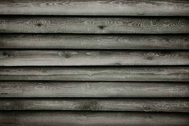 古い暗い灰色の木製の壁のテクスチャ