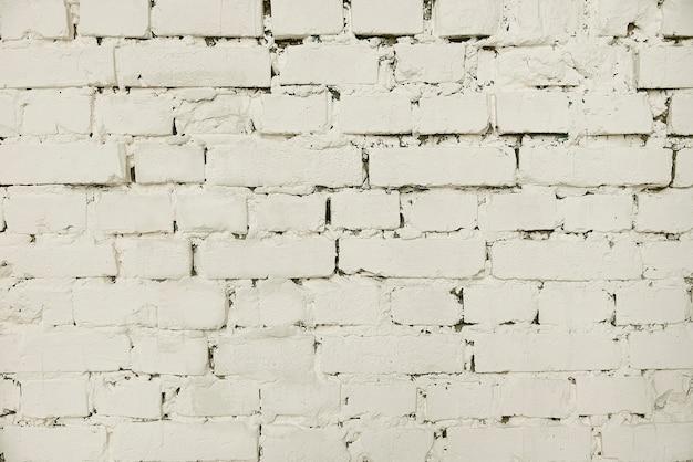 古い白い塗られたレンガの壁の背景