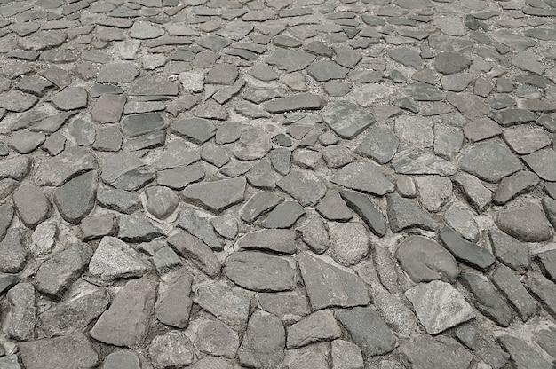 古い灰色の石畳の背景