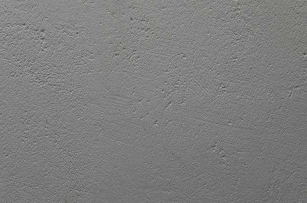 Неровная окрашенная серо-голубая бетонная стена