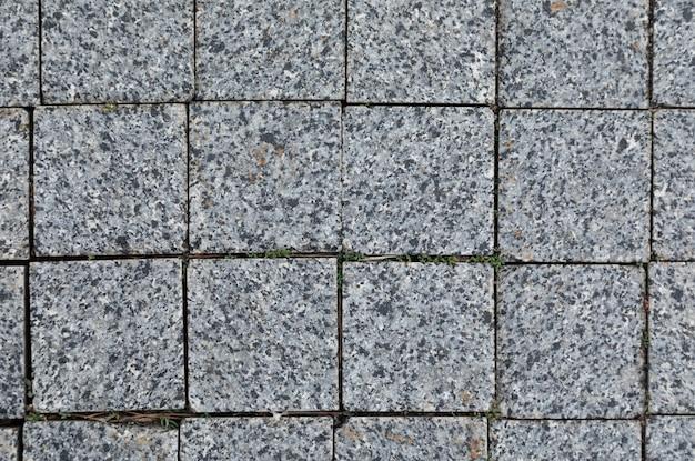 グランジテクスチャと滑らかな灰色の花崗岩のタイル