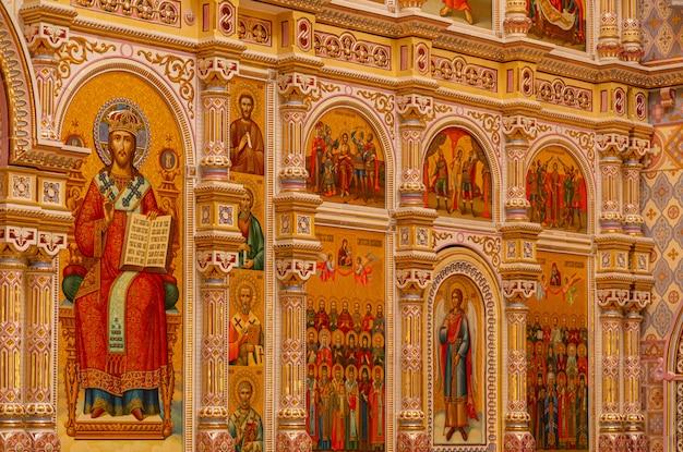 Роспись святых на стене в храме всех святых