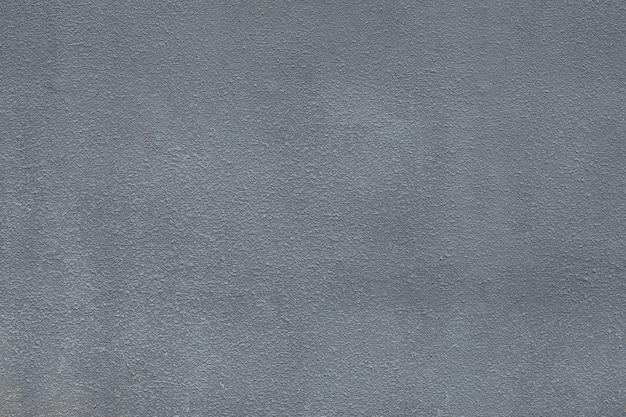 Грубая стена серого цвета жилого дома