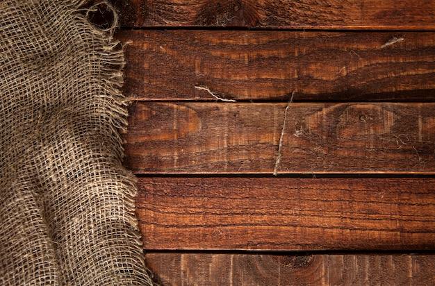 Текстура мешковины на деревянный стол