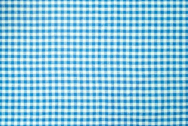 青い市松模様のテーブルクロスの背景