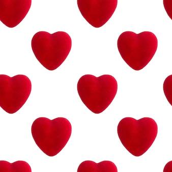 赤いハートのシームレスなパターン、バレンタインデーのコンセプト