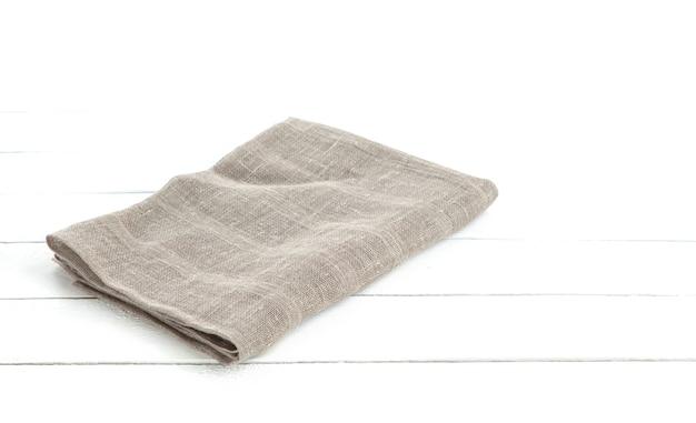 製品のモンタージュの白い木製の表面に黄麻布のヘシアン