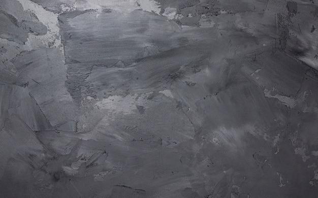 漆喰の質感、コンクリートの背景を持つ灰色のセメントの壁
