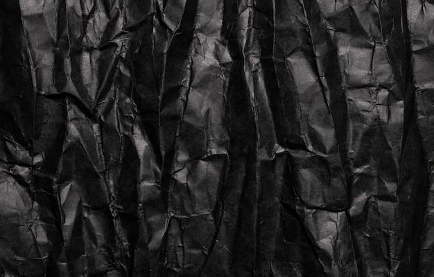 黒のしわくちゃの紙のテクスチャ、グランジ背景